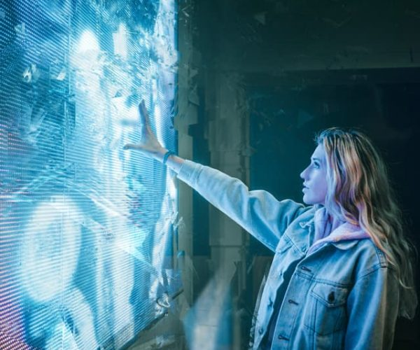 Woman Touching an LED Screen